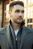 Street fashion. Portrait of handsome man in trendy casual coat. Stock Photos