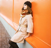 Street fashion portrait pretty girl in coat and hat posing Royalty Free Stock Image