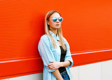 Street fashion portrait pretty woman in sunglasses Stock Image
