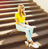 Street fashion, pretty stylish woman relaxing in city Stock Images
