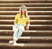 Street fashion, pretty stylish young woman in city Royalty Free Stock Photo