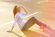 Street fashion, pretty woman enjoying summer having fun Stock Image