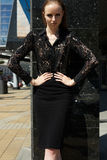 Street fashion style. Beautiful model in chic lace shirt & skirt Royalty Free Stock Photos