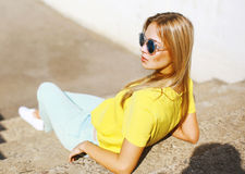 Street fashion, stylish pretty hipster girl in sunglasses posing Stock Photography