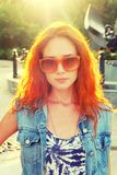 Street fashion women in orange sunglasses backlit. Stock Photos
