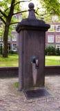 Street faucet in Begijnhof. Amsterdam. Stock Photo