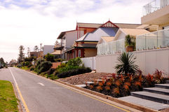 Street featuring various architecture styles of Australian homes. Beach side street featuring various architecture styles of Australian homes stock images