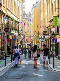 Street festivity in the historical `Vieux Lyon` neighborhood in Lyon, France. LYON, FRANCE - CIRCA JUNE 2015: Street festivity in the historical `Vieux Lyon` stock image