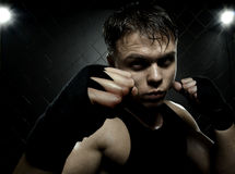 Street fighter. Horizontal photo  muscular young  guy street-fighter,  aggression look, hard light Stock Photo
