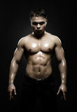 Street fighter. Vertical photo  muscular young  guy street-fighter,  aggression look, hard light Stock Images