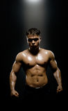 Street-fighter. Vertical photo  muscular young  guy street-fighter,  aggression look, hard light Royalty Free Stock Photo