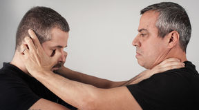 Street fighting self defense technique against holds and grabs Royalty Free Stock Photos
