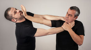Street fighting self defense technique against holds and grabs Royalty Free Stock Photography