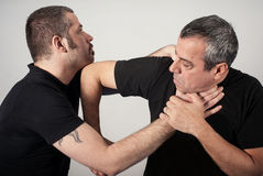 Street fighting self defense technique against holds and grabs Royalty Free Stock Image