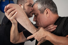 Street fighting self defense technique against holds and grabs Stock Photo