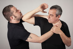 Street fighting self defense technique against holds and grabs Stock Images