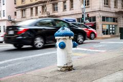 Street fire-hydrant in San Francisco. An Oberflurhydrant, blue-white in San Francisco stock photography