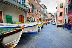 Street with fishing boats in an Italian village Manarola Royalty Free Stock Photo