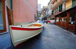 Street with fishing boats in a traditional Italian village Manar Royalty Free Stock Images