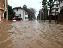 Street flooded with mud and debris during a flood in town. Street flooded with mud and debris during a major flood in town royalty free stock photo