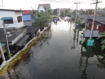 A street is flooded near Pathum Thani, Thailand, in October 2011.  Stock Photos