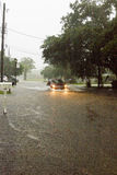 Street Flooding. Car drives through street flooding during heavy rain Stock Photos