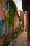 Street with flower pots. In southern French village Stock Image