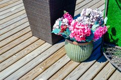 Outdoor flower pots flowers. On the porch. Home from a bar. Against the house flowers. Street flower pots flowers on stone wall background royalty free stock photography