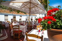 Street with flowers in the Mijas town, Spain Stock Images