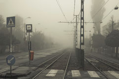 Street in fog. With rail transport stock photo