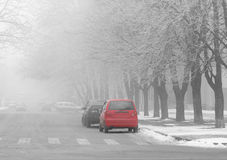 Street at foggy winter morning. Street of town at foggy winter morning Royalty Free Stock Image