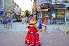 Street folk parade woman. Mexican woman in national costumes at folklore fest street parade.Picture taken on August 3rd 2014 Varna Bulgaria royalty free stock photography