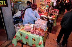 Street food. Autochthonous cook preparing a delicious dish Stock Photo