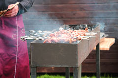 Street food: barbecue (chicken meat) charbroiled (cooked over an open fire) Stock Photo