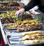 Street food, barbecue, meat, cooked on the grill. Street food, barbecue, meat, sausages and sandwiches cooked on the grill royalty free stock photography