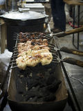Street food, barbecue, meat, cooked on the grill. Street food, barbecue, meat, sausages and sandwiches cooked on the grill stock images