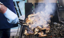 Street food, barbecue, meat, cooked on the grill. Street food, barbecue, meat, sausages and sandwiches cooked on the grill stock photo