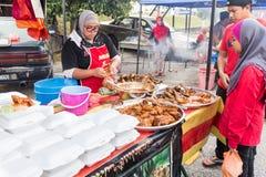 Street food bazaar in Malaysia catered for iftar during Ramadan. KUALA LUMPUR, MALAYSIA, June 7, 2016:  First day of Ramadan with food vendors at street bazaar Stock Images