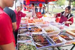 Street food bazaar in Malaysia catered for iftar during Ramadan. KUALA LUMPUR, MALAYSIA, June 7, 2016:  First day of Ramadan with food vendors at street bazaar Stock Photography