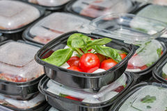 Street food box with mozzarella cheese, cherry tomatoes and basil. Royalty Free Stock Photography
