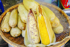 Street food in Burmese market , Myanmar. Boiled corns in the flat and large basket, Burmese market, Myanmar. Myanmar is one of the mysterious country in South stock photo