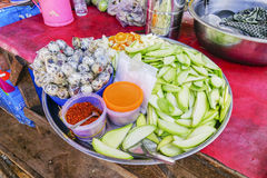 Street food in Burmese market, Myanmar. Boiled quail eggs and mango slices in Burmese market, Myanmar. Myanmar is one of the mysterious country in South East royalty free stock photos