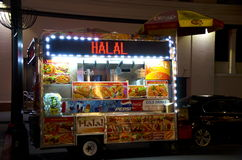 Street Food Cart. A street food cart in New York City advertises halal food suitable for consumption by observant muslims for sale Stock Images