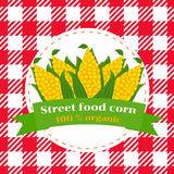 Street food corn. Corn cobs are a cartoon. Sign Street food corn. Seamless pattern of checkered tablecloth Stock Photos