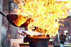 Street Food Festival. Cooking Food On Fire. Street Food Festival. Cooking Food In Wok On Fire Outdoors. High Resolution royalty free stock image