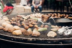 street food festival. grilled meat and vegetables mushrooms. roasting beef pork on big grill, open kitchen, food court. cooking s royalty free stock photography