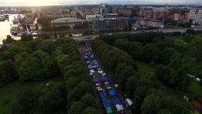 The street food festival in Kaliningrad, top view. The street food festival in Kaliningrad in evening time, top view stock video footage