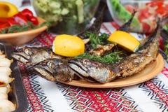 Street food. Fried fish stock photo