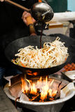 Street Food. Fried Noodles In A Wok With Chicken Stock Image