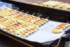 Street food, fried tteok, Seoul, South Korea. Close-up, side view, outdoor stock image